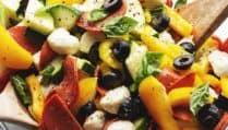 antipasto salad in a glass bowl