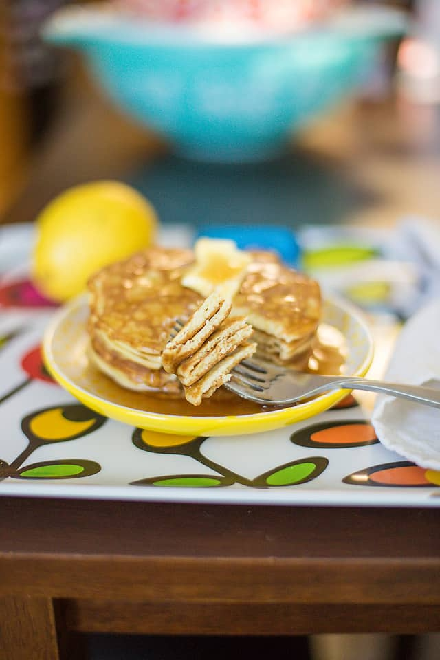 low carb pancakes on a yellow plate with a lemon