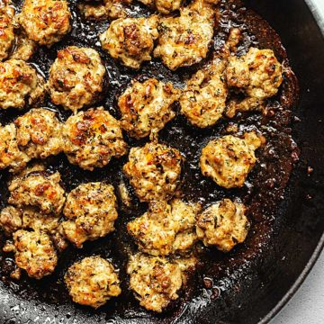 keto sausage and cheese stuffed mushrooms in a skillet