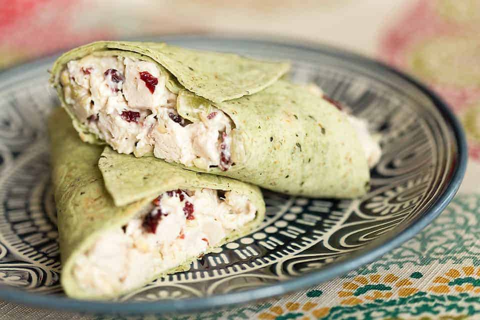 low carb cranberry almond chicken salad in a green wrap
