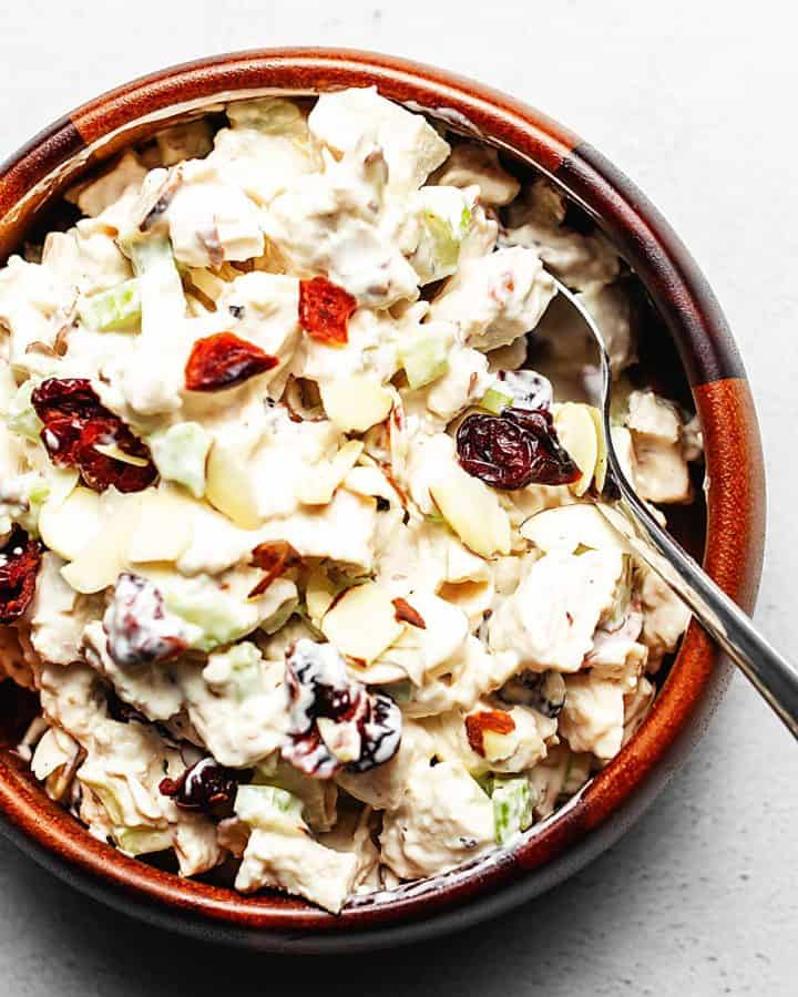 chicken salad with cranberries and almonds in a wooden bowl
