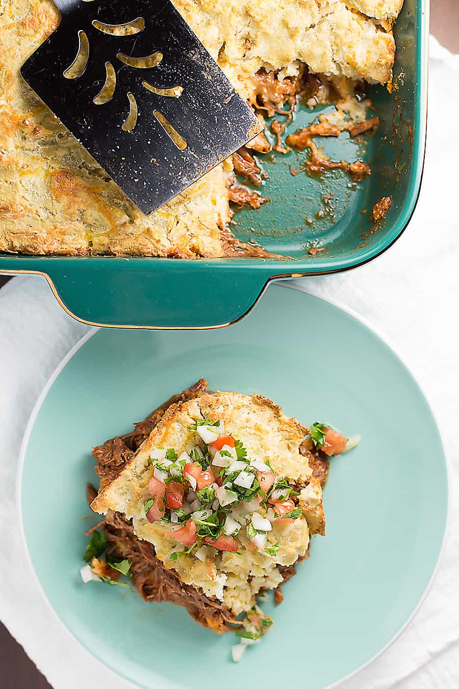"This low carb tamale pie is so full of flavor and gluten free! Saucy shredded beef, melty cheese, and a low carb ""cornbread"" crust."