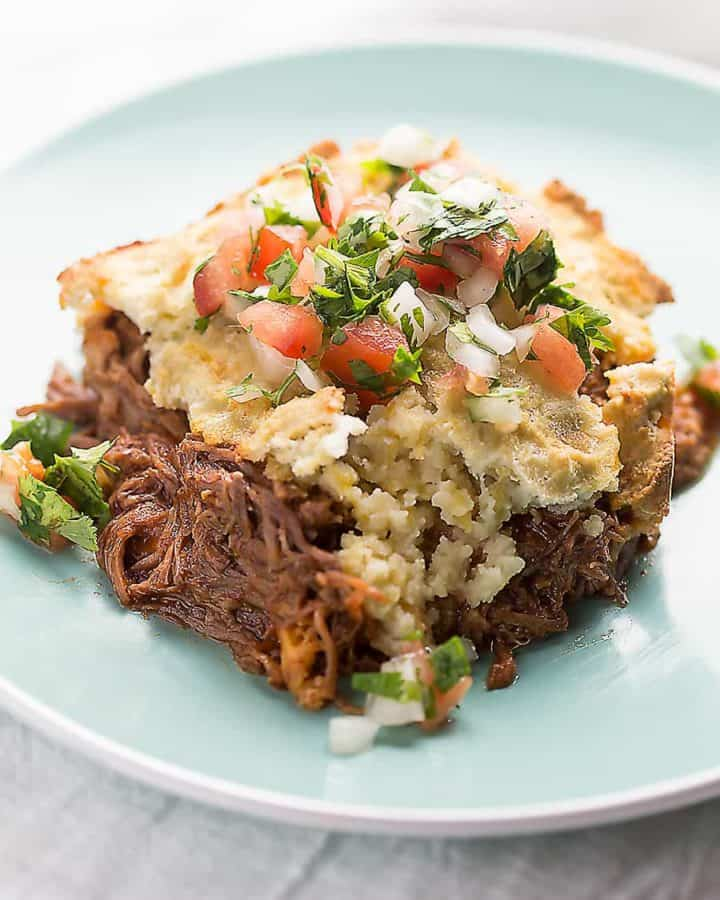 a serving of low carb tamale pie on a blue plate