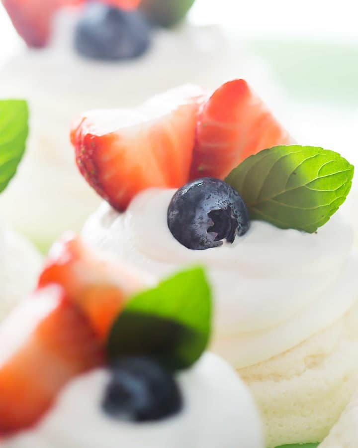 Impress everyone with this beautiful recipe of low carb mini pavlovas! Perfect for a Mother's Day dessert or just because!