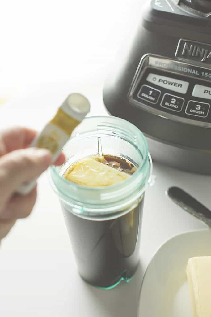 ninja blender and the blender cup. coffee and butter in the blender cup