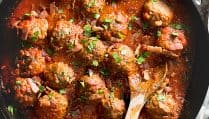 Gluten Free Meatballs with Bacon Tomato Sauce. Serve with lemony kale for the perfect low carb meal.