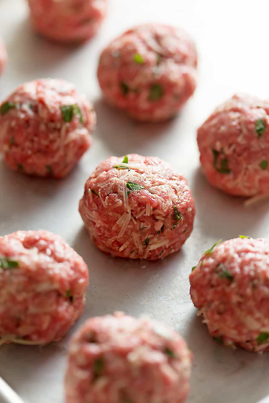 Gluten Free Meatballs with Bacon Tomato Sauce. Serve with lemony kale for the perfect low carb dinner. No noodles here!