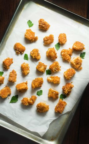 pork rind chicken nuggets baked on a sheet pan