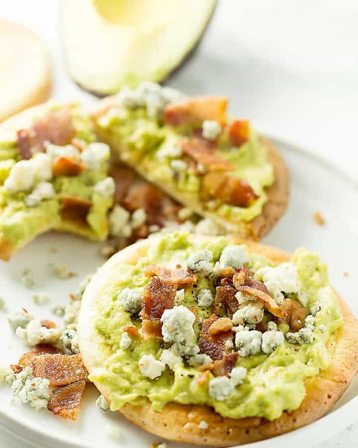 mashed avocado on oopsie rolls with bacon and blue cheese on top