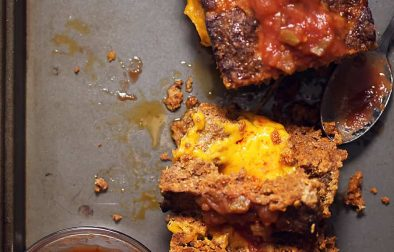 cheese stuffed meatloaf on a sheet pan with salsa