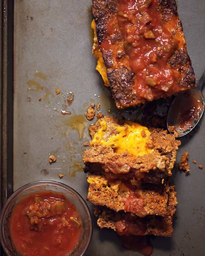 Mexican meatloaf on a sheet pan with salsa