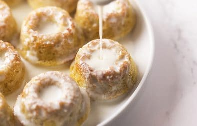 These cute little low carb and sugar free donuts are so easy to make, you will be whipping up a batch every time you have a craving.  Each one is drenched in a delicious sweetened cream so they are super moist and only 1.4 net carb each!