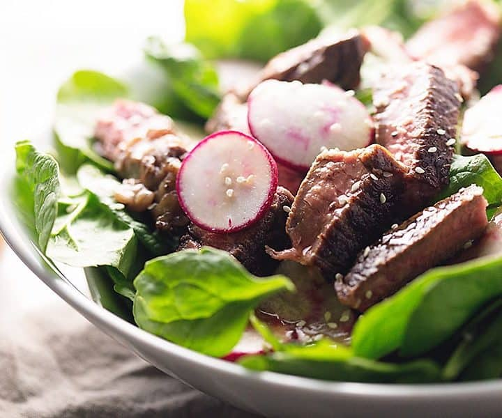 This easy asian steak salad uses only one ingredient to marinate the steak and the asian sesame dressing mixes up quickly in a jar. A super simple weeknight dinner