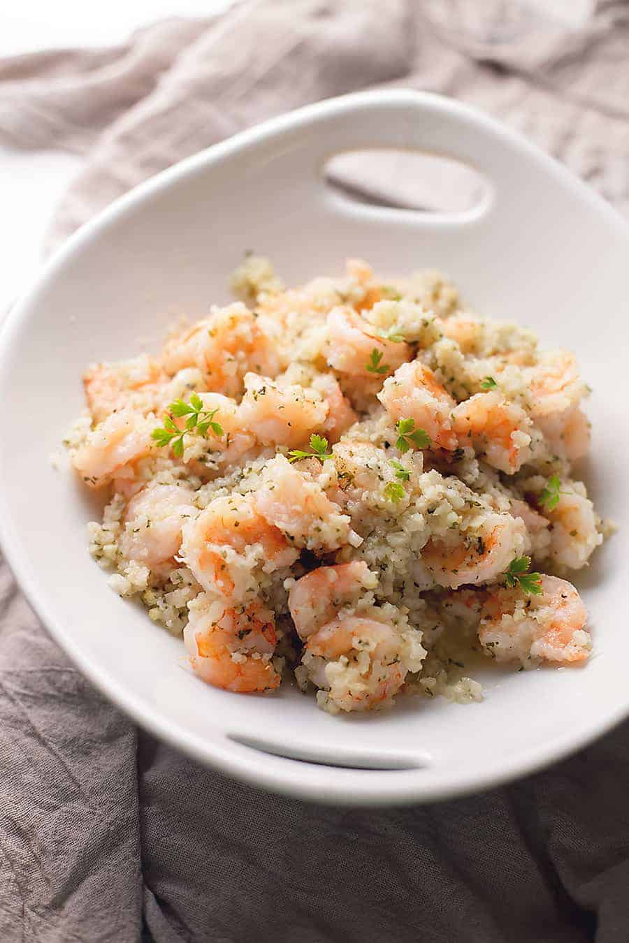 garlic butter shrimp with cauliflower rice in a white bowl