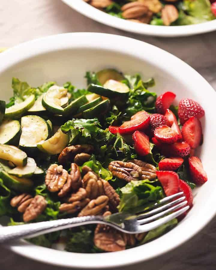 This low carb breakfast salad is full of fresh kale, strawberries, zucchini, and pecans. So nutritious and a perfect healthy start to your morning!