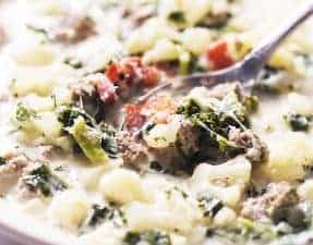 a bowl of low carb zuppa toscana soup with a spoon