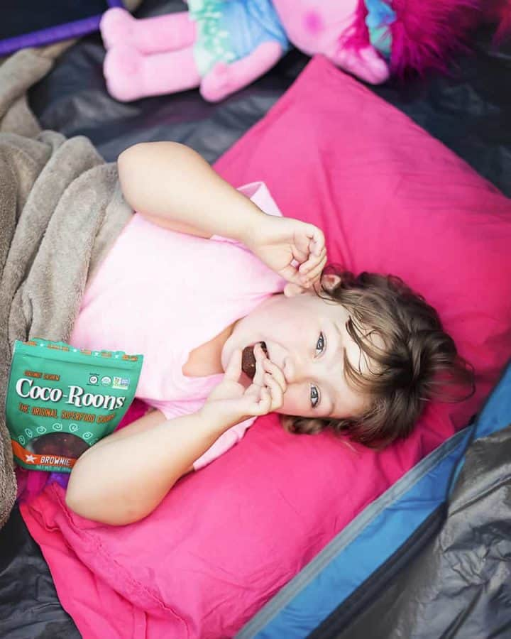 a little girl eating brownie coco-roons