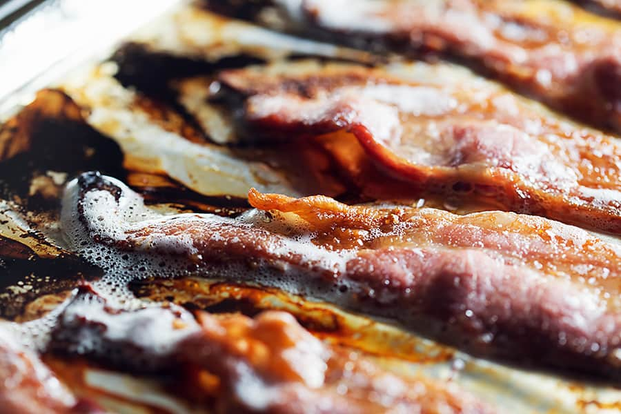 Cooked bacon on a sheet pan