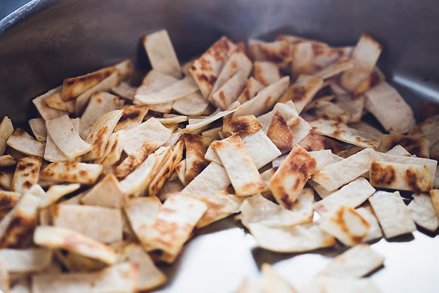 tortillas strips sautéed in oil until crispy
