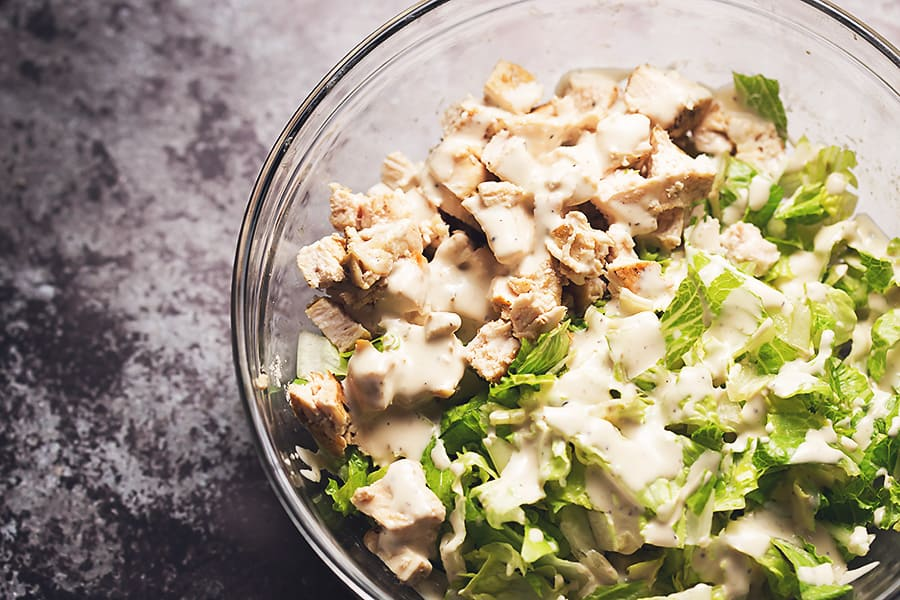 chicken caesar salad in a glass bowl