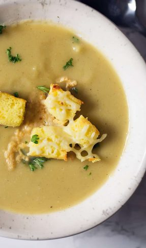 A bowl of acorn squash soup with croutons