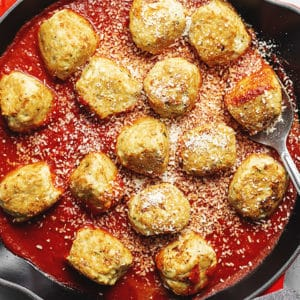 chicken parmesan meatballs in a skillet