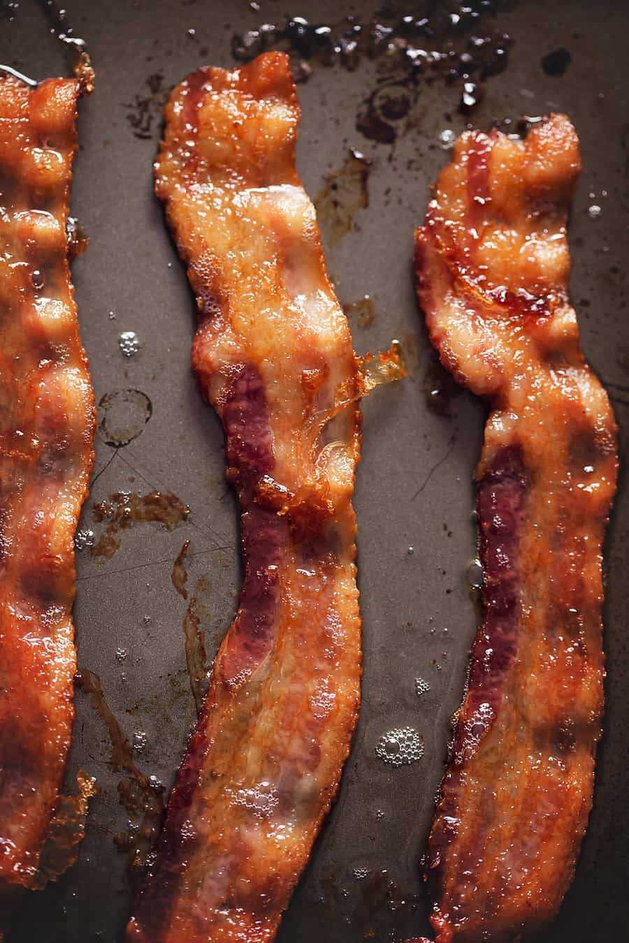 bacon cooked in the oven on a sheet pan
