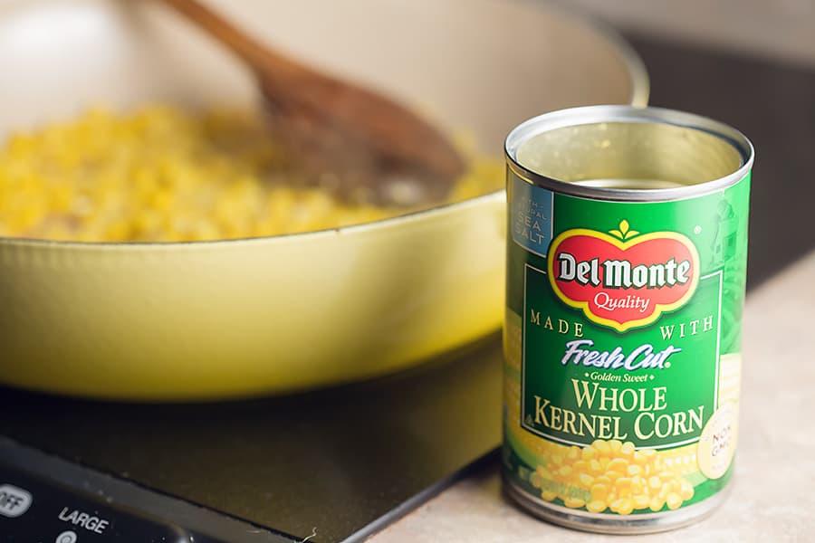 corn cooking a yellow le crueset saucier