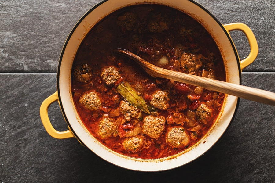 mexican meatball soup in a yellow dutch oven