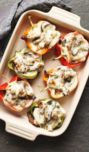 philly cheesesteak stuffed peppers in a baking dish