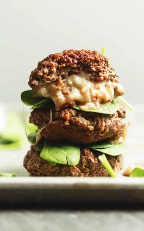stuffed burgers stacked on top of each other