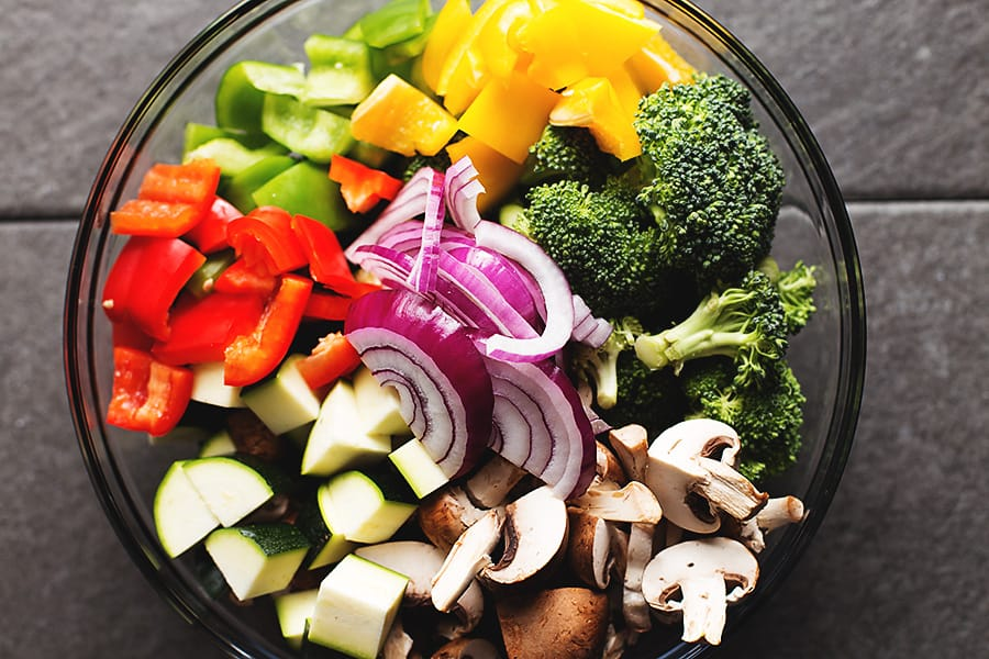 a big bowl full of colorful veggies