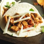 slow cooker chicken tacos on a sheet tray
