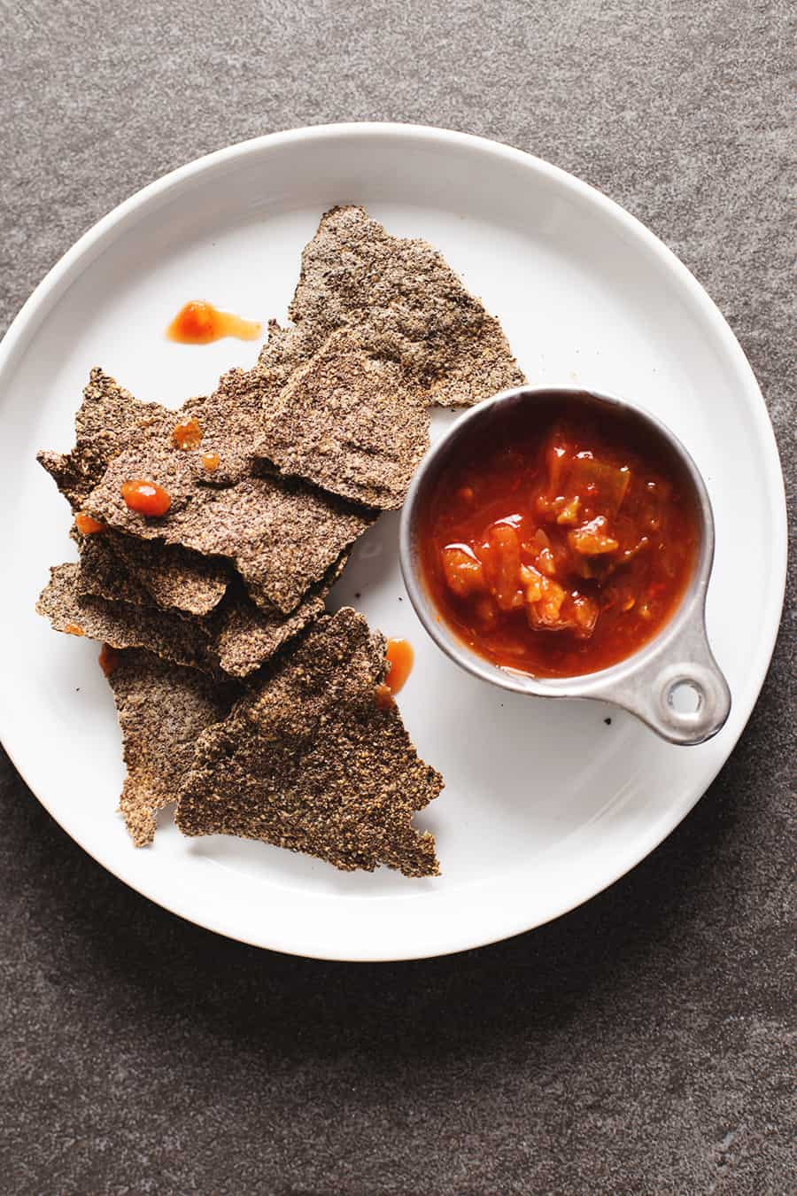 low carb tortilla chips on a plate with salsa