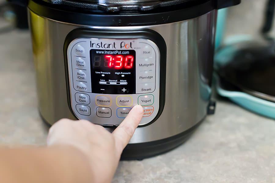 Instant pot yogurt function being pressed