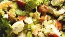 a close up shot of chicken salad with avocado and bacon