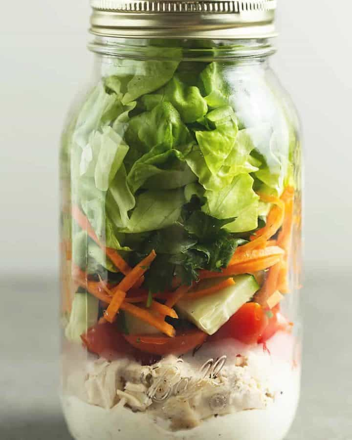 a mason jar with salad in it