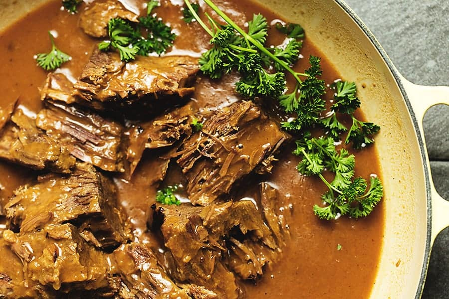 rump roast and gravy with curly parsley