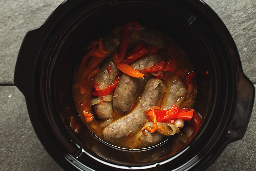 crock pot sausage and peppers cooked in a crock pot