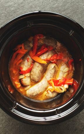 sausage and peppers in a black crock pot