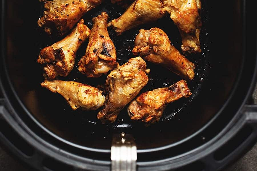 cooked chicken wings in the air fryer basket