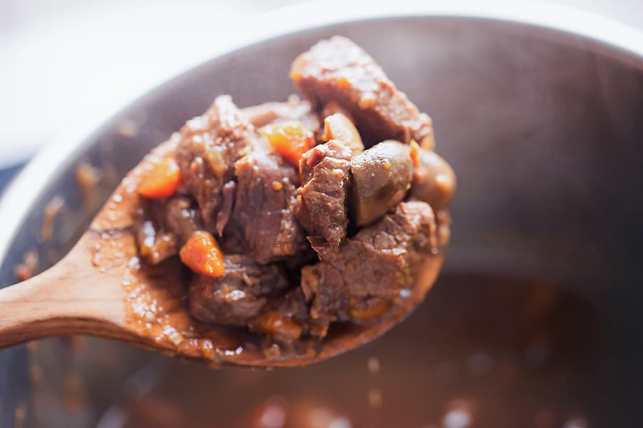 instant pot beef stew on a spoon