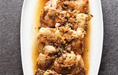 tuscan chicken on a white platter