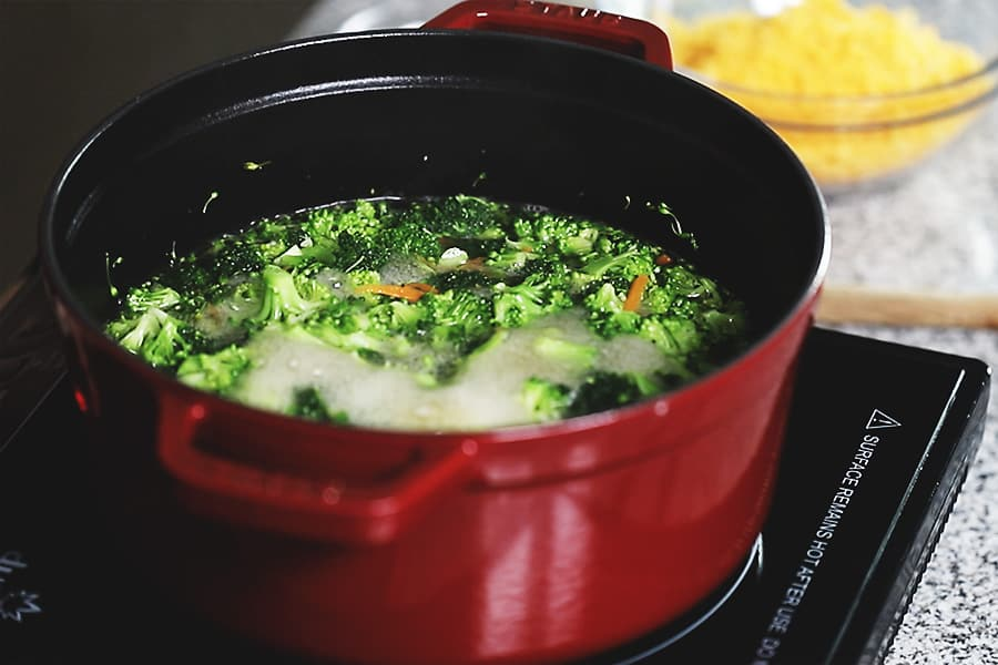 broccoli simmering in a red pot
