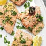 lemon pepper salmon on a white plate