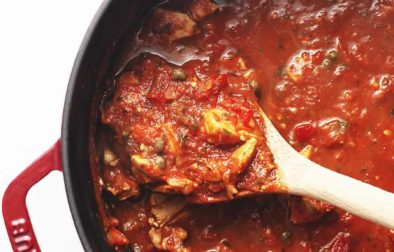 chicken cacciatore stew in a red dutch oven