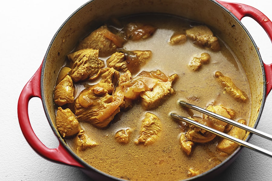 Indian curry chicken in a red pot
