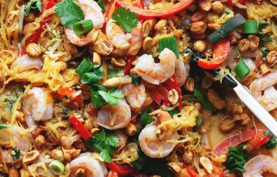 keto spaghetti squash pad thai with shrimp in a large skillet with tongs