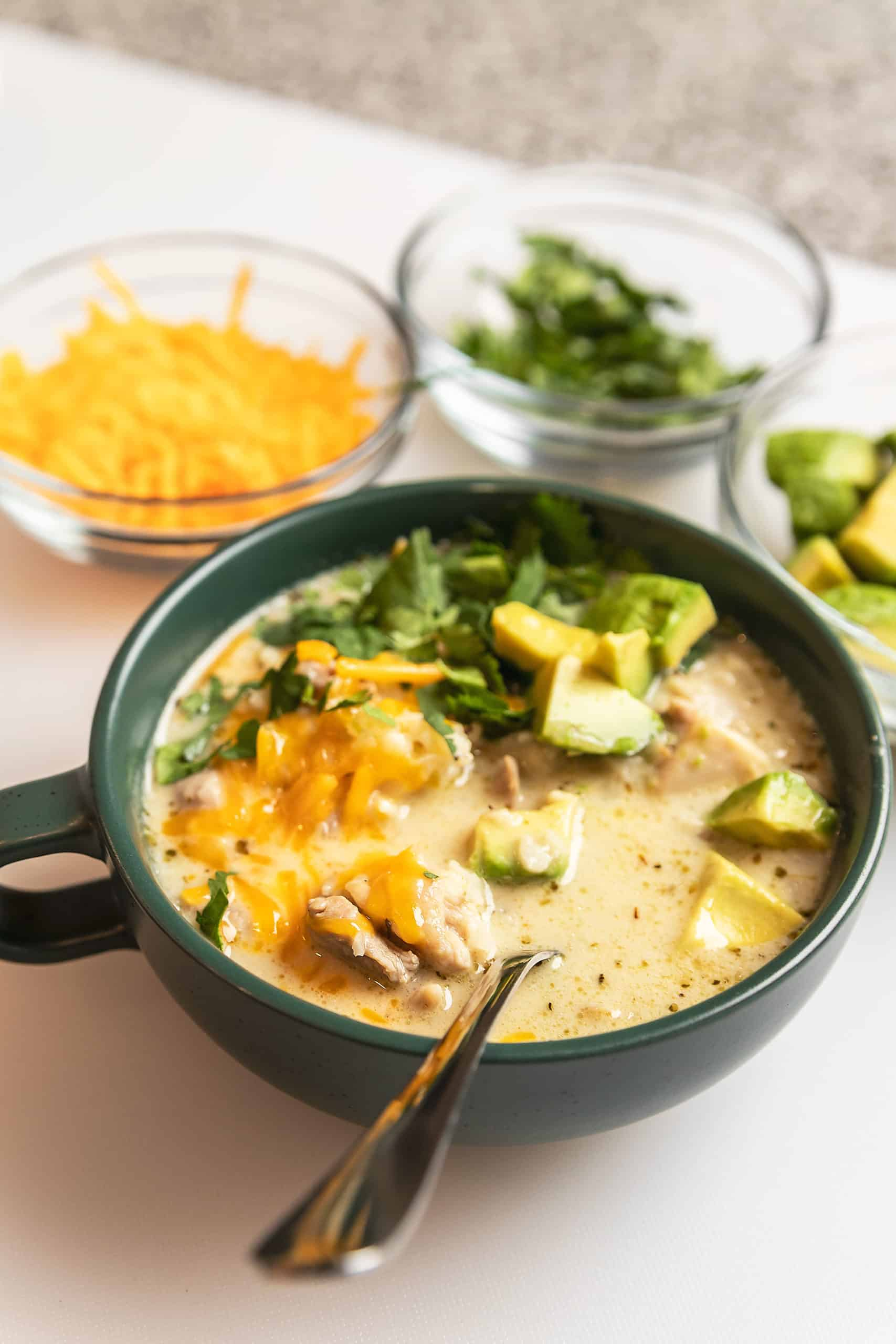 keto white chicken chili in a green bowl