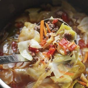 A ladle of unstuffed cabbage soup in an instant pot